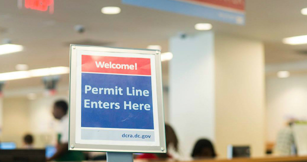 Sign with text saying permit line starts here