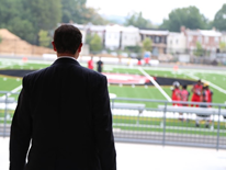 Mayor Vicent Gray watching the Dunbar football players practice on the new athletic field.