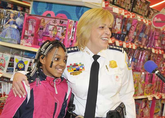 "Chief Lanier shops with a child during ""Shop with a Cop"""