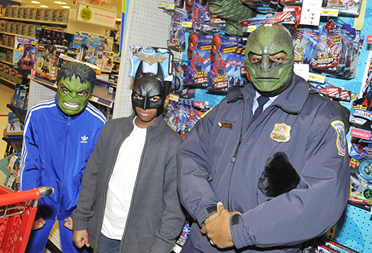 "Kids enjoy a moment of fun with an MPD officer during ""Shop with a Cop"""