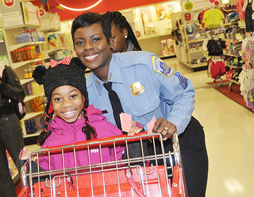 "A young girl ""Shops with a Cop"" on Thursday, December 20, 2012"