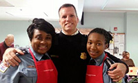 Assistant Chief Patrick Burke with cadets at a soup kitchen.