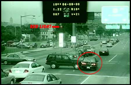 photo of crash at traffic intersectin taken by traffic camera