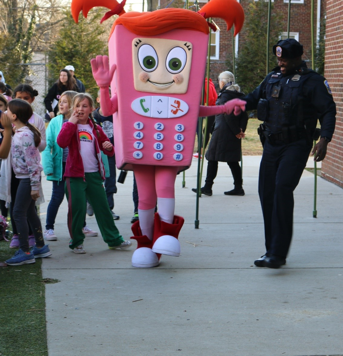 Cell Phone Sally, OUC's mascot, visits students with Officer Friendly.
