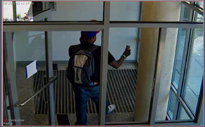 photo from security camera of person leaving building
