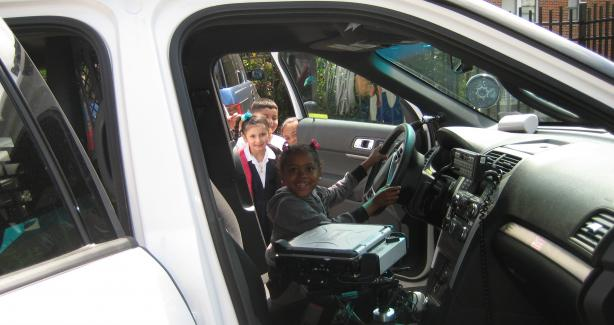 HD Cooke Elementary School student explores the interior of an MPD patrol vehicle