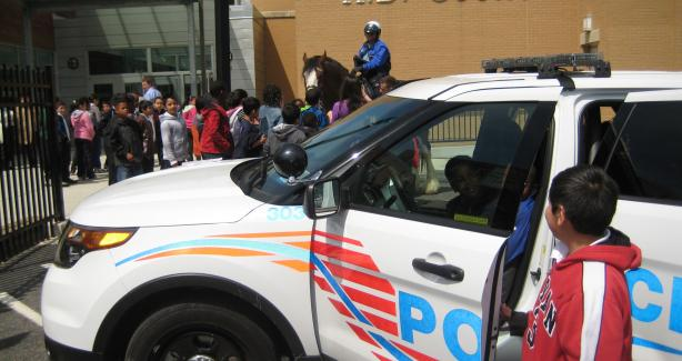 Members of the MPD visit HD Cooke Elementary School for Career Day