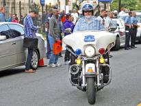 Reserve Officer Currie on motorcycle.