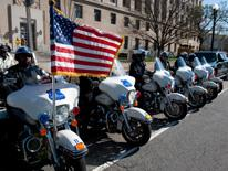 Line of MPDC motorcycles and American flag