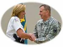 photo of Chief of Police Cathy Lanier shaking hand of an Army Reservist