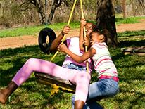 Kids Play on a Tire Swing
